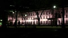 London Birdcage walk night people walking silhouette Stock Footage