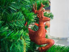 Christmas reindeer trinket on Christmas tree, selective focus Stock Photos