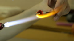 Producing of glass bead in workshop, eighth video Stock Footage