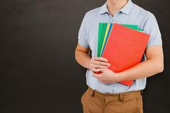 Composite image of mid section of man holding files - stock photo