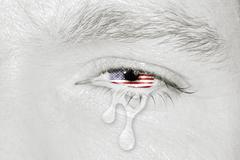 Crying eye with American Flag - stock photo
