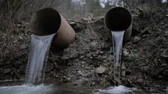 With a large flow pipe waste directly into the river Stock Footage