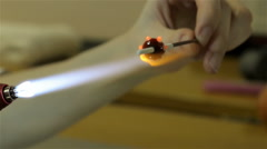 Producing of glass bead in workshop, twelfth video - stock footage