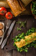 French omelet, fluffy, fresh eggs and herbs Stock Photos