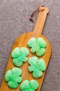 Tasty green shamrock cookies for St Patrick's Day - stock photo
