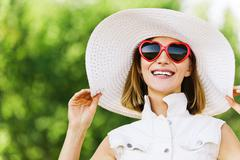 Portrait young charming woman white hat red sunglasses Stock Photos