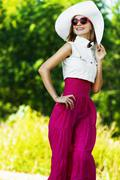 Cheerful charming young woman white hat sunglasses Stock Photos