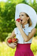 woman wiht wicker basket holds red apples - stock photo