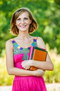 Stock Photo of beautiful young woman with books