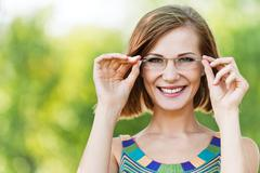 Portrait beautiful young woman funny glasses Stock Photos