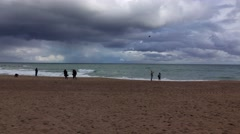 Heavy rainy clouds over Balearic Sea, keen wind at empty beach in Barcelona Stock Footage