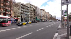 Empty Passeig Joan de Borbo at daytime, few cars ride at straight driveway Stock Footage