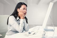 Composite image of exhausted businesswoman with hands on face Stock Photos