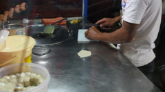 BANGKOK, THAILAND - Man cooks pancake with bananas and sweet milk, traditional Stock Footage