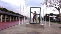 Mark sculpture at Olympic Port park, slide shot, empty alley from flagpoles Stock Footage