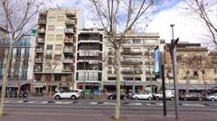 Residential houses against city road, long slide shot. Barri de la Barceloneta Stock Footage
