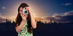 Composite image of smiling asian woman taking photograph with camera Kuvituskuvat