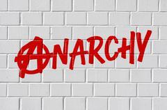 Graffiti on a brick wall - Anarchy - stock photo