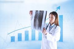 Composite image of asian doctor checking mri scan Stock Photos