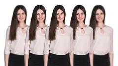 Women clones standing in a row Stock Photos