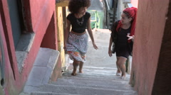 Two funky young women climbing up the staircase Stock Footage
