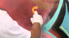 Young man painting graffiti on wall Stock Footage