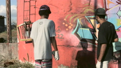 Two funky young men painting Graffiti Stock Footage