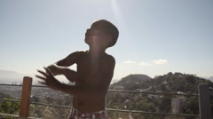 Shirtless boy flying a kite - stock footage