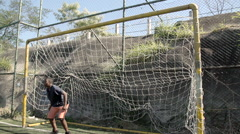 Teenage boy saving a goal Stock Footage