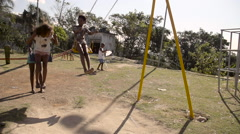 Four Children playing in a play park Stock Footage