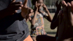Mid section of children playing clapping game - stock footage
