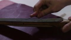 The shoemaker's sharpening tool. Cobbler sharpening a knife. The knife for the s Stock Footage