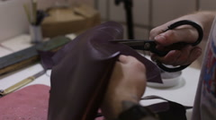 Shoemaker cutting leather in a workshop, close up. Cobbler cut skin Arkistovideo