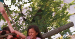 Group children playing on the rope ladder of treehouse - stock footage