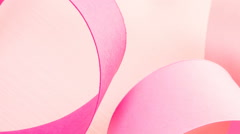 Womens health symbol in pink ribbon on a pink background. - stock footage