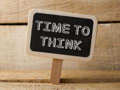 Time to think concept wooden sign on wood background Stock Photos