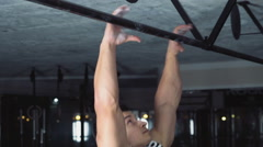 Stock Video Footage of male athlete doing standard pull-ups at the gym slow motion