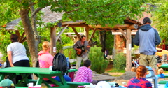 4K Singer and Guitar Player, Live Acoustic Music, Cardboard House Bakery, Hornby Stock Footage
