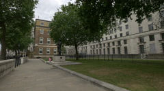 Sitting near Field Marshal The Viscount Slim Statue in London Stock Footage