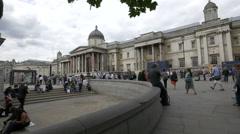 Tourists visiting Trafalgar Square in London Stock Footage