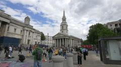 Walking near St Martin-in-the-Fields Church in London Stock Footage