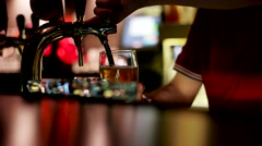 Keg beer yellow flowing in transparent glass with foam at the bar. Stock Footage