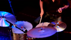 Drummer beats sticks on drum kit at the club at performance. Stock Footage