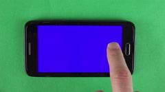 Smart phone finger swipe. Green background Stock Footage