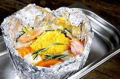 Meat with vegetables in foil on Protvino Stock Photos