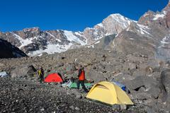 Alpine Climbers Camp in Morning - stock photo