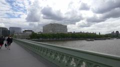 Tourists walking on Westminster bridge in London Stock Footage