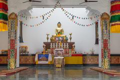 Buddha Statue inside Canadian temple in Lumbini, Nepal - stock photo