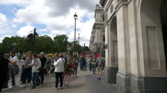 Many tourists visiting and walking on Bridge Street in London Stock Footage
