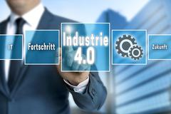 Industrie 4.0 in german industry touchscreen is operated by businessman backg - stock photo